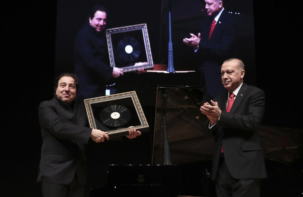 President Erdou011fan applauds Fazu0131l Say (L), world-renowned Turkish pianist and composer, after his classical music concert, Ankara, Jan. 18.