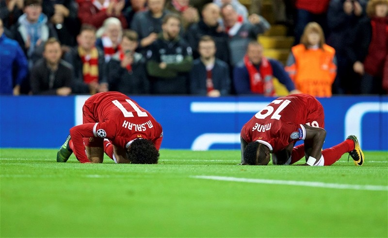 Liverpoolu2019s Mohamed Salah, left, and his teammate Sadio Mane performing sujood, or prostrating in Muslim prayer, during the UEFA Champions League Group E match between Liverpool and Sevilla at Anfield.Liverpool, U.K.