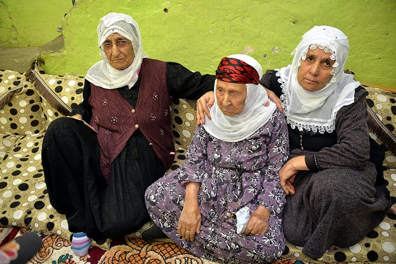 u015eahe Tayurak sits among two of her children aged 90 and 80. (DHA Photo)