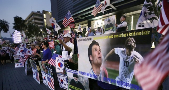 Supporters stage a memorial rally for the late American student Otto Warmbier near the U.S. Embassy in Seoul, South Korea, Friday, June 23, 2017. (AP Photo)