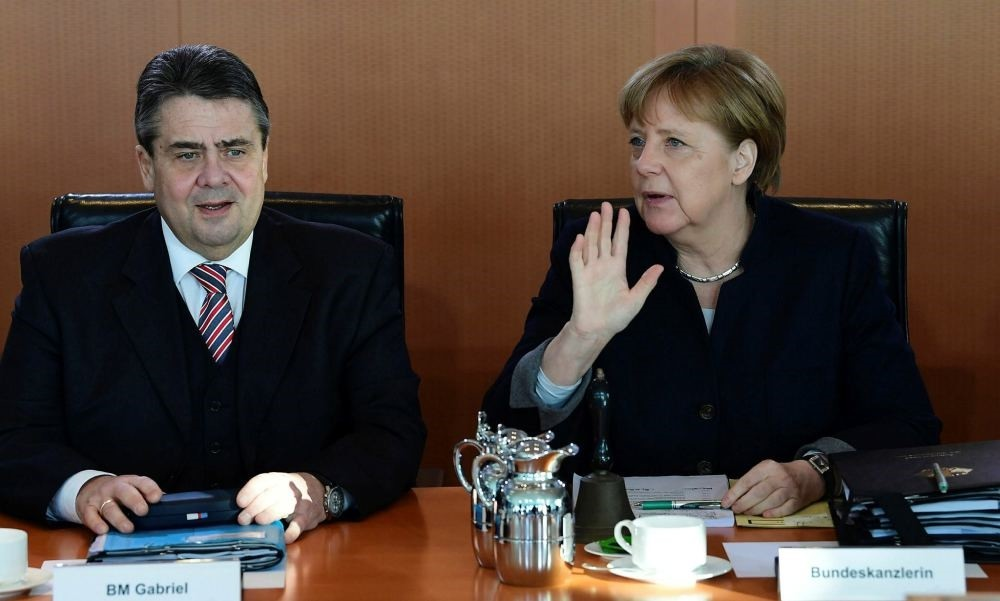 German Chancellor Angela Merkel and German Vice Chancellor and Foreign Minister Sigmar Gabriel wait for the opening of the weekly cabinet meeting on Feb. 15 at the Chancellery in Berlin.