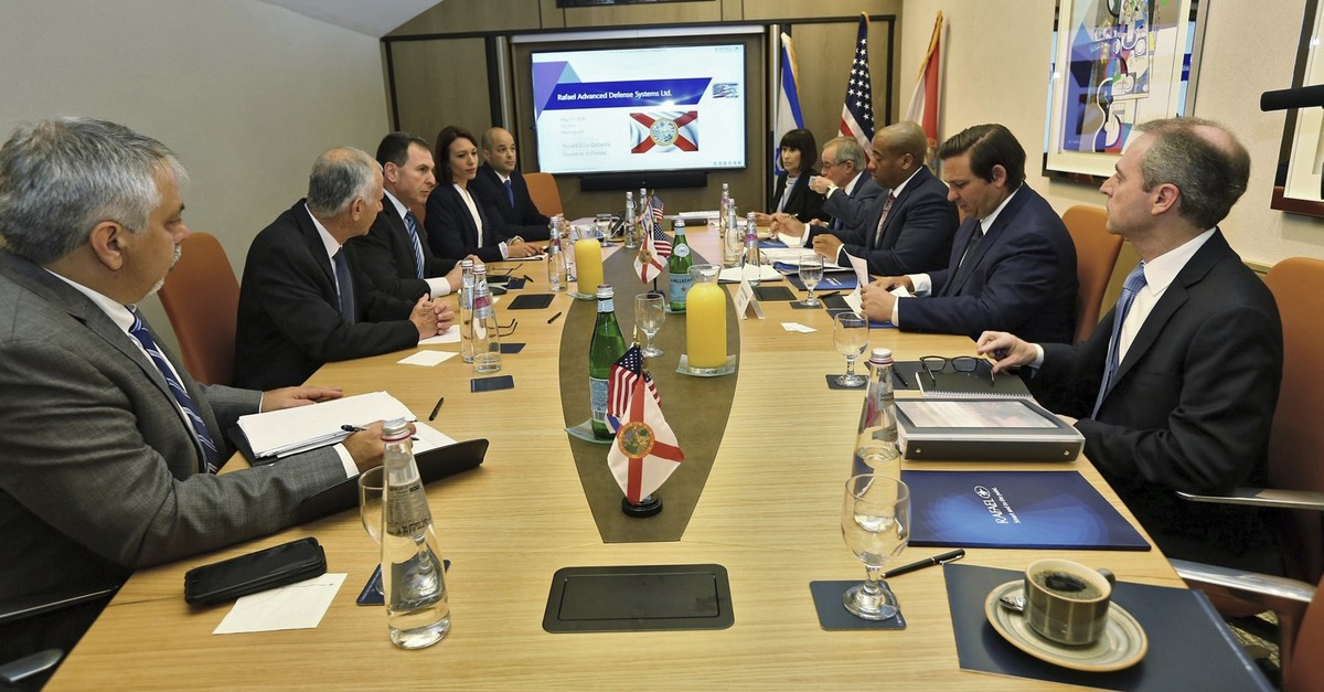 Florida Gov. Ron DeSantis, second from right, meets with representatives of Rafael, a military and defense technologies development firm, during a trade visit to Israel Monday May 27, 2019. (AP Photo)