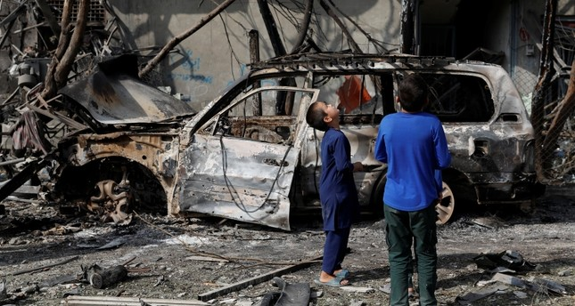 Afghan boys look the site of Sunday's attack in Kabul, Afghanistan July 29, 2019. (Reuters Photo)