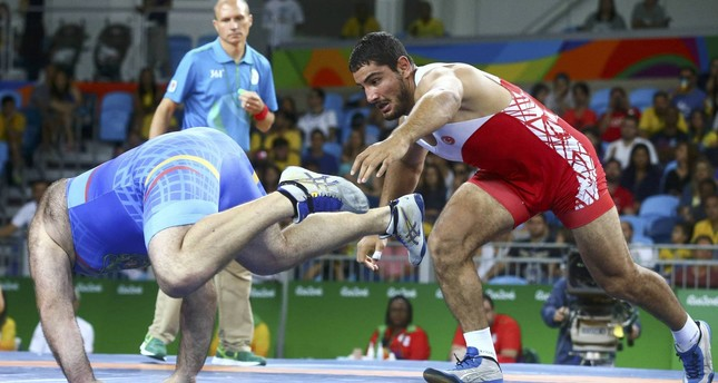 Taha Akgul (red) of Turkey in action against Levan Berianidze (blue) of Armenia during the men's Freestyle 125kg semi final bout of the Rio 2016 Olympic Games Wrestling events. (EPA Photo)