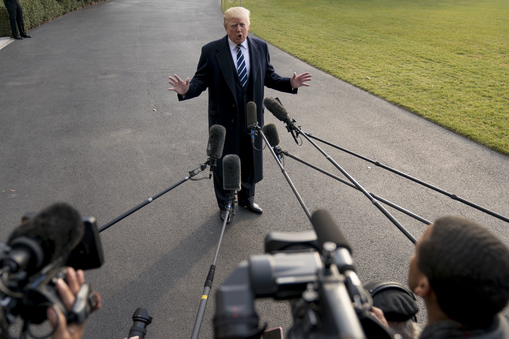President Donald Trump speaks to members of the media before boarding Marine One at the White House, Saturday, Dec. 2, 2017, in Washington.(AP Photo)