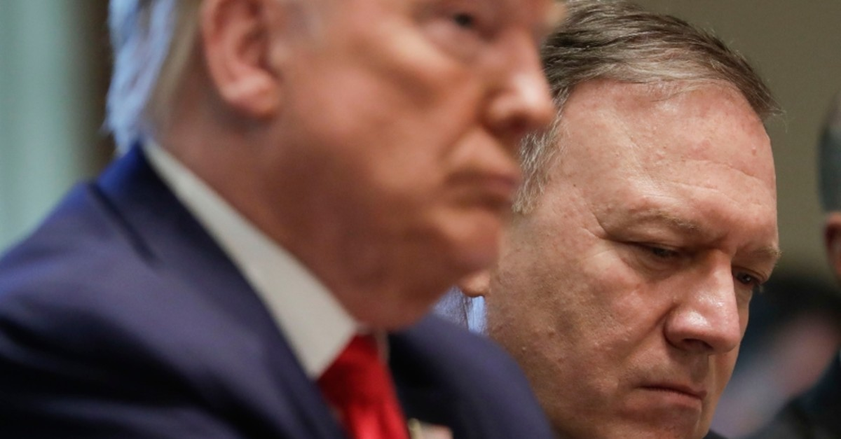 Secretary of State Mike Pompeo, right and President Donald Trump, left, listen during a Cabinet meeting in the Cabinet Room of the White House, Monday, Oct. 21, 2019, in Washington. (AP Photo)