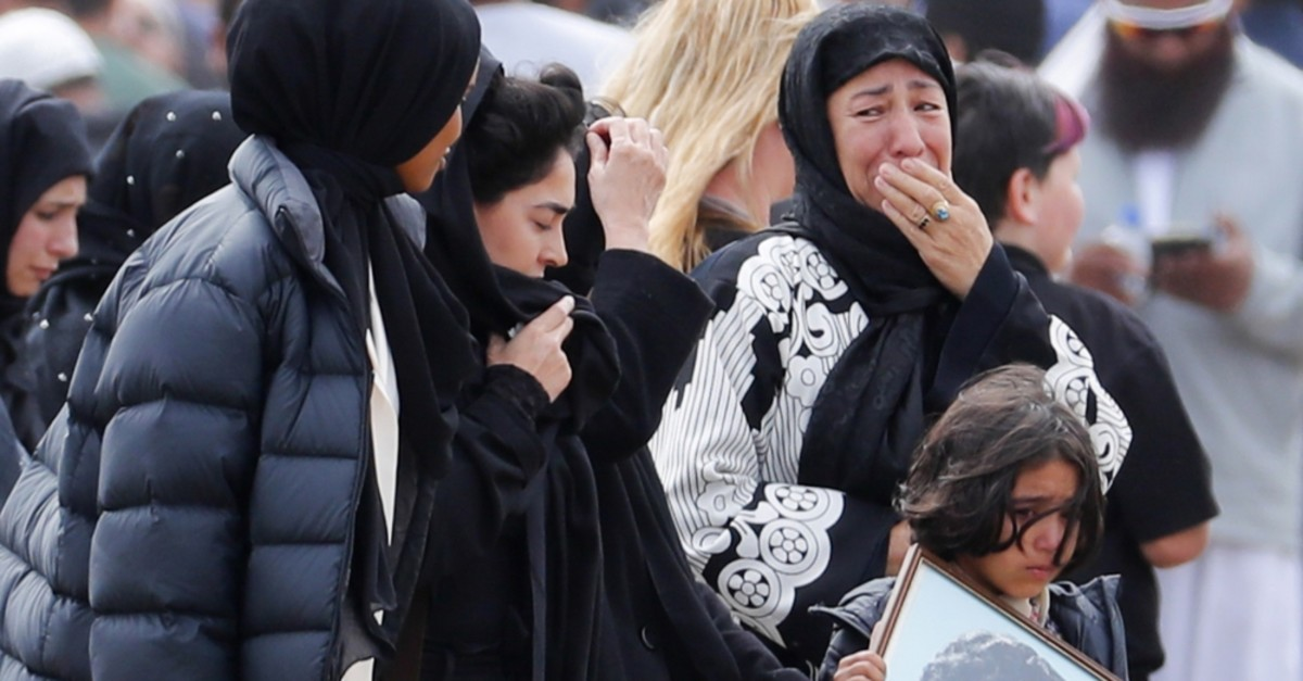 Mourners arrive for the burial service of one of the victims from the March 15 terrorist attack, at the Memorial Park Cemetery in Christchurch, March 21, 2019.