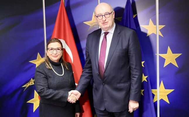 Trade Minister Ruhsar Pekcan L shakes hand with European Commissioner for Trade Phil Hogan, Brussels, Belgium, Dec. 20, 2019. AA Photo