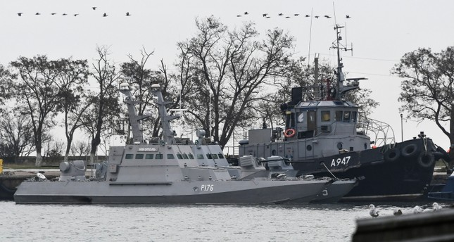 Three Ukrainian ships are seen as they docked after being seized by Russia on Sunday, Nov. 25, 2018, in Kerch, Crimea, Monday, Nov. 26, 2018. (AP Photo)