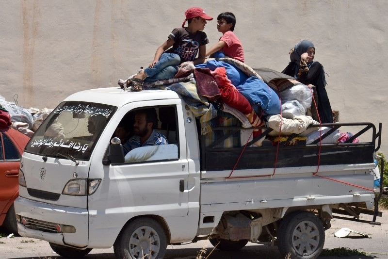 Displaced Syrians from the Daraa province come back to their hometown in Bosra, southwestern Syria, on July 11, 2018. (AFP Photo)