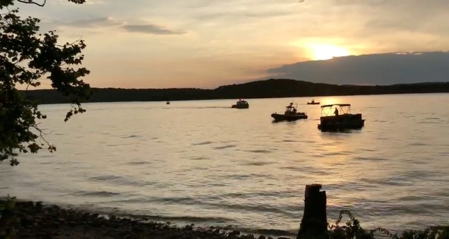 Rescue personnel work after a duck boat capsized and sank, at Table Rock Lake near Branson, Missouri, U.S. July 19, 2018 in this still image obtained from a video on social media (Southern Stone County Fire Protection District / Facebook / Reuters)