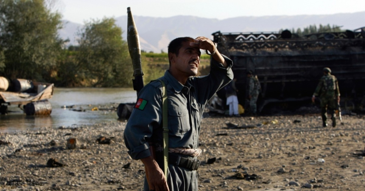 In this Saturday, Sept. 5, 2009 file photo Afghan police inspect the site where villagers reportedly died when American jets bombed fuel tankers hijacked by the Taliban, outside Kunduz, Afghanistan. (AP Photo)