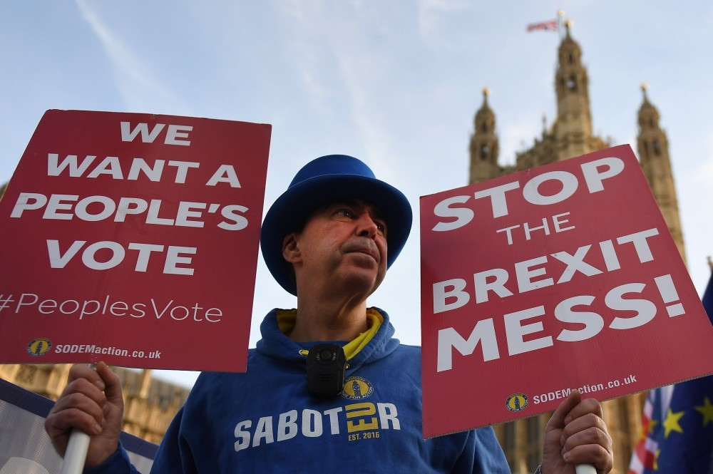 Pro-EU protesters demonstrate outside Parliament calling for a people's vote in London, yesterday.