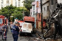 2 dead, 12 injured as plane crashes in Sao Paulo neighborhood