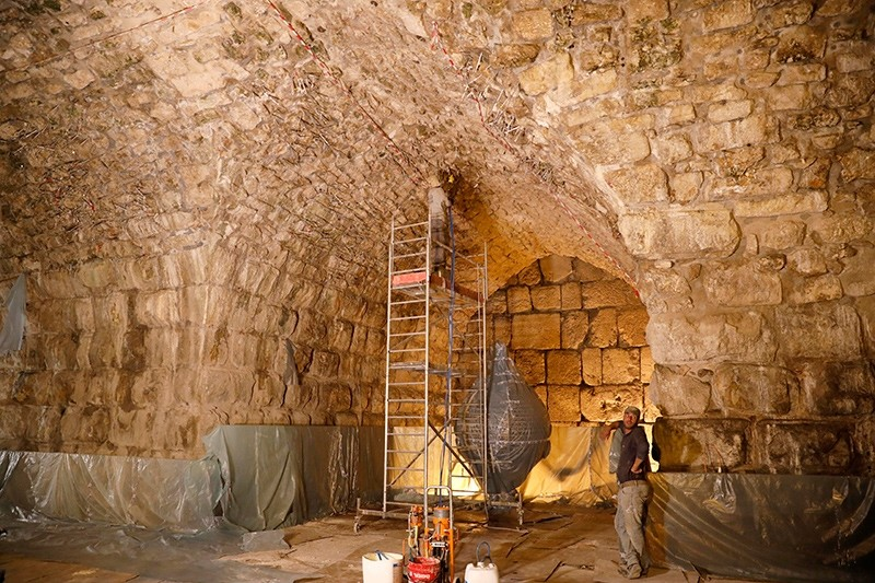 Workers at the Western Wall Tunnels in Jerusalem's Old City, 16 October 2017 (EPA Photo)