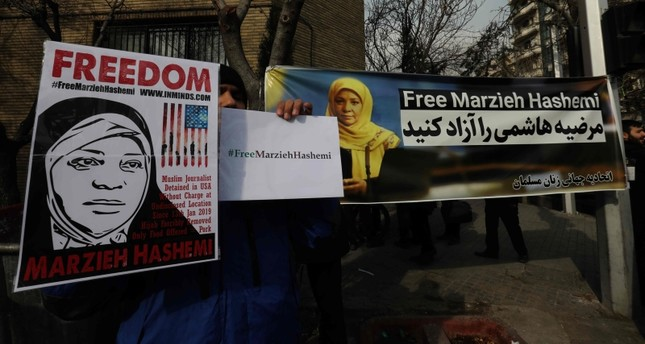 Iranians hold banners bearing messages that call for the release of US-born journalist Marzieh Hashemi, near the Swiss embassy in the capital Tehran on January 20, 2019 AFP Photo