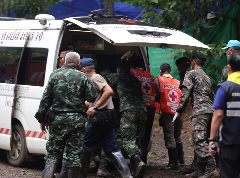 A handout photo made available by the Chiang Rai Public Relations Office shows authorities placing a rescued boy in an ambulance in Khun Nam Nang Non Forest Park, Thailand, 08 July 2018. (EPA Photo)