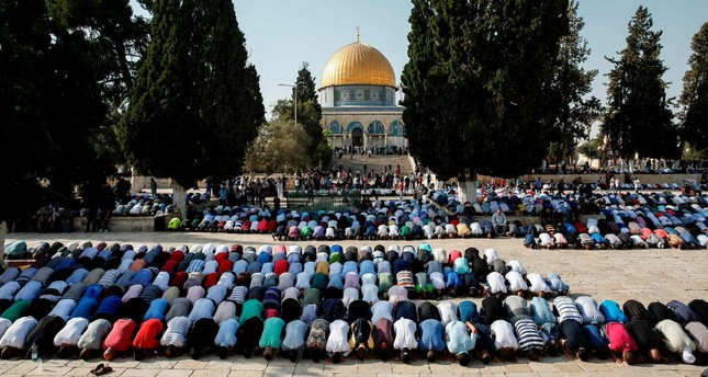 Palestinian Muslims pray inside the Haram al-Sharif compound, known to Jews as the Temple Mount, in the old city of Jerusalem.