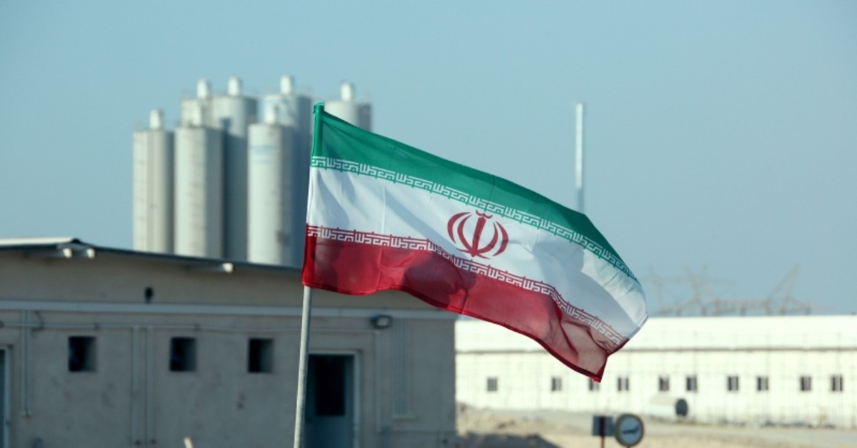In this file photo taken on November 10, 2019 an Iranian flag flutters in Iran's Bushehr nuclear power plant, during an official ceremony to kick-start works on a second reactor at the facility. (AFP Photo)