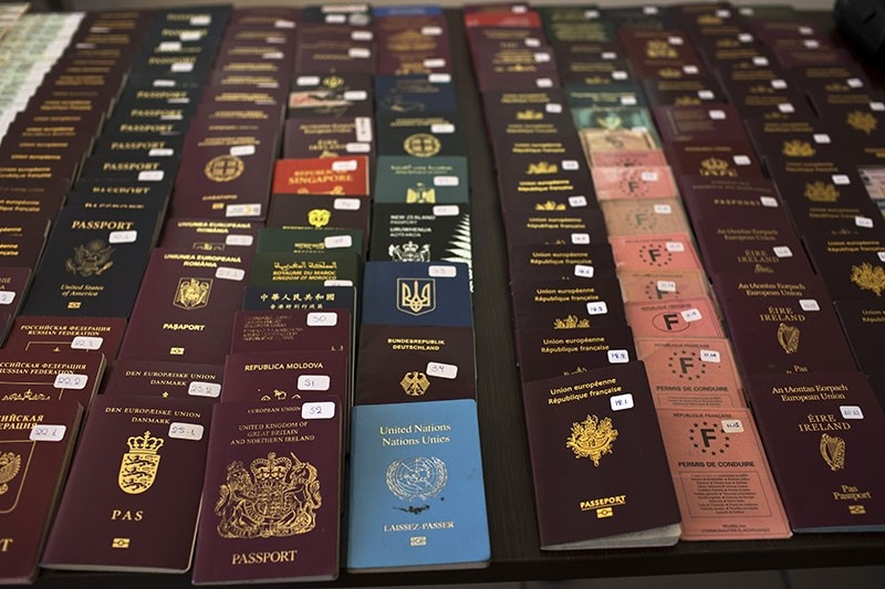 In this Wednesday, Feb. 28, 2018 photo Greek authorities present confiscated passports and identification cards at the Athens Police Headquarters. (AP Photo)