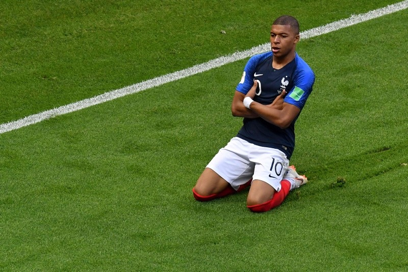 France's Kylian Mbappe celebrates after scoring his team's third goal during the Russia 2018 World Cup round of 16 football match between France and Argentina at the Kazan Arena in Kazan on June 30, 2018. (AFP Photo)