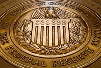Fed holds rates steady, says economy remains on track