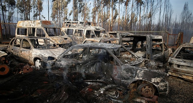 Burnt vehicles are seen after a forest fire in Miro, near Penacova, Portugal,  October 17, 2017. (Reuters Photo)