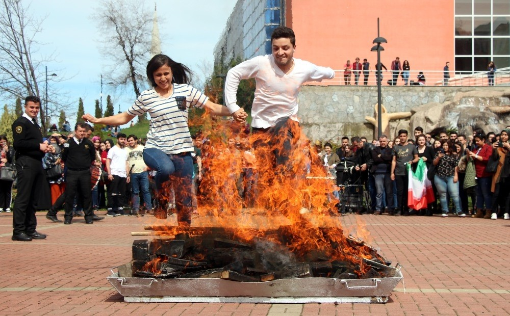 People jump over a bonfire in a Nevruz celebration in the northern city of Zonguldak.