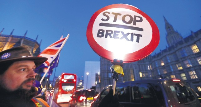 A pro-EU demonstrator holds a banner near parliament in London, Jan. 17, 2019.
