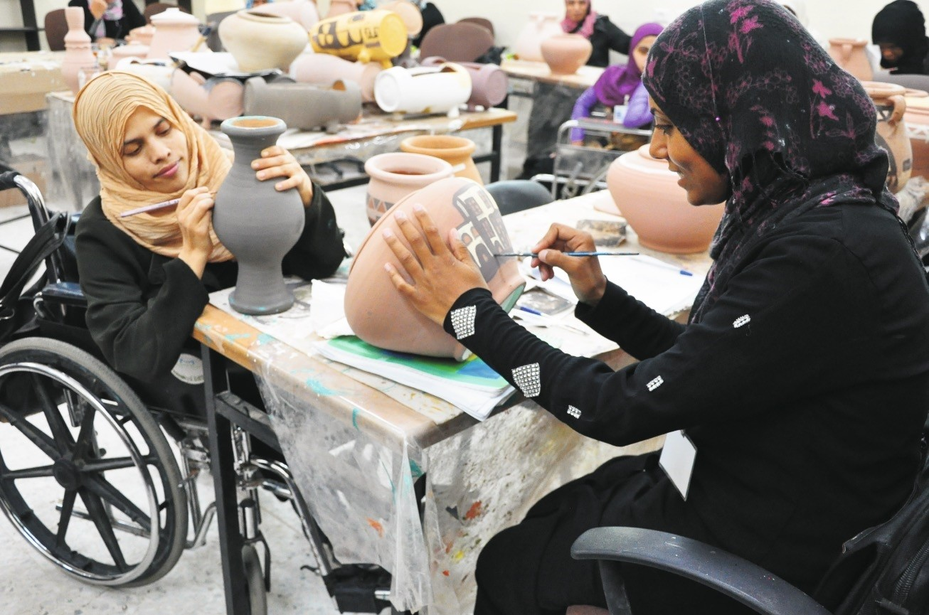 Palestinian women in Gaza attend a pottery painting class endorsed by Tu0130KA.