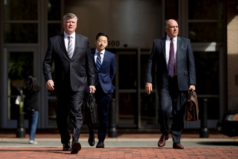 Members of the defense team for Paul Manafort, Kevin Downing, left, and Thomas Zehnle, right, arrive at federal court for a hearing in the criminal case against former Trump campaign chairman Paul Manafort, Oct. 19, 2018 (AP Photo)