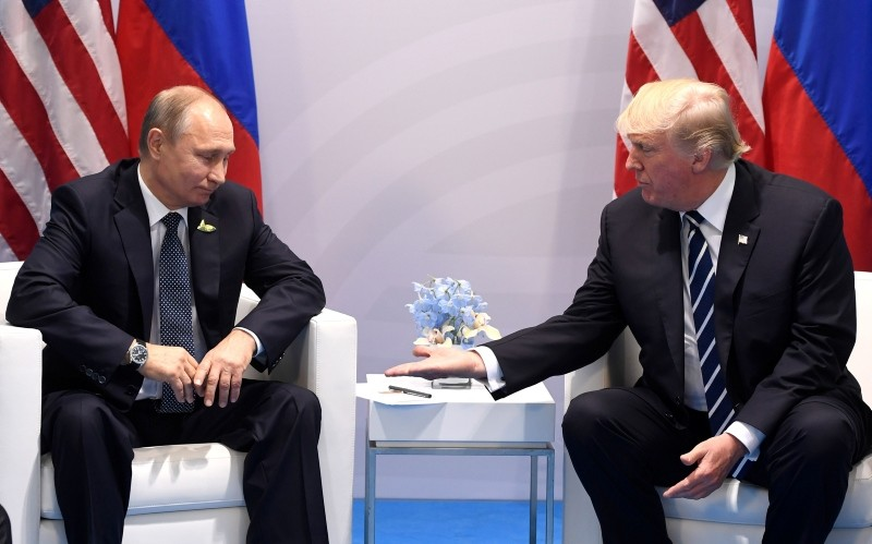 In this file photo taken on July 07, 2017 US President Donald Trump and Russia's President Vladimir Putin shake hands during a meeting on the sidelines of the G20 Summit in Hamburg, Germany. (AFP Photo)