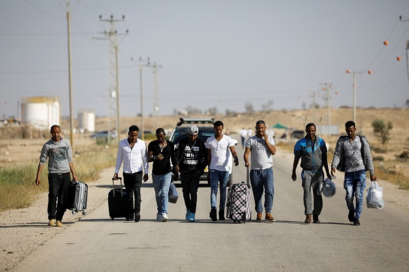 African migrants walk on a road after being released from Saharonim Prison in the Negev desert, Israel April 15, 2018. (Reuters Photo)