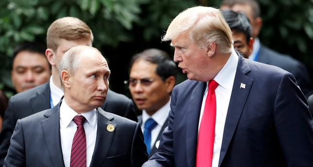 U.S. President Donald Trump and Russia's President Vladimir Putin talk during the family photo session at the APEC Summit in Danang, Vietnam November 11, 2017. ( Reuters Photo)