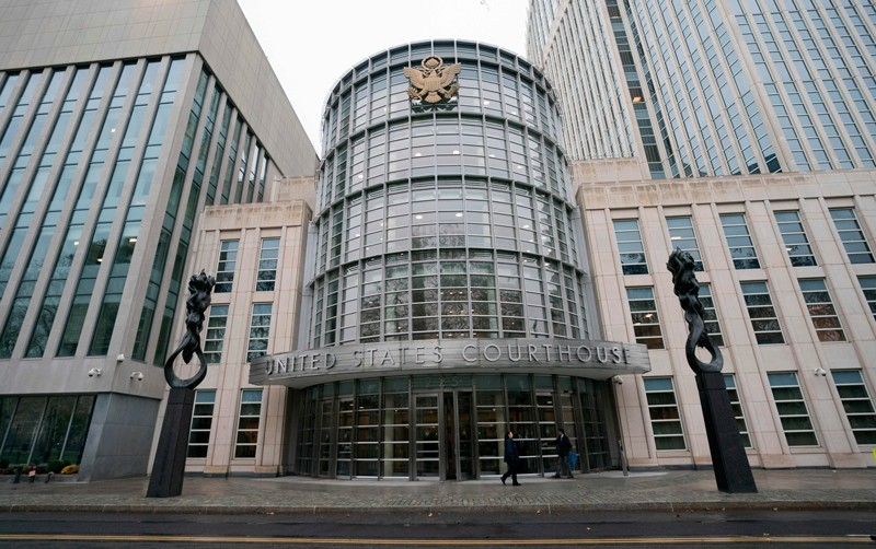 People wak past the Federal Courthouse in Brooklyn where the FFA trial is talking place on November 13, 2017 in New York ( AFP Photo)