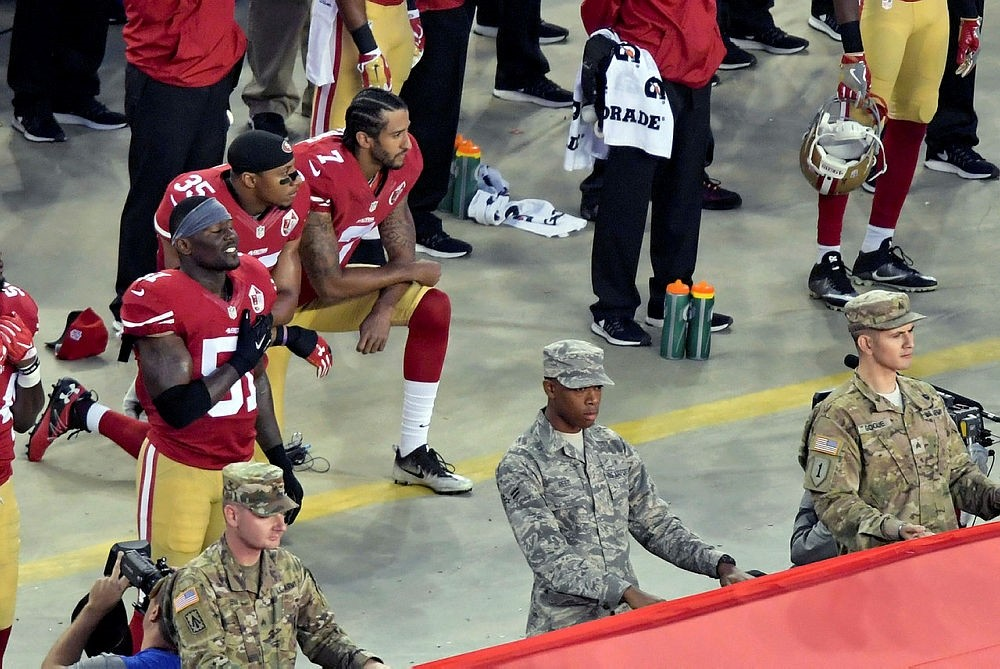 San Francisco 49ers quarterback Colin Kaepernick and teammate Eric Reid kneel during the playing of the national anthem in Santa Clara, California, Sep 12, 2016. (Kirby Lee-USA TODAY Sports)