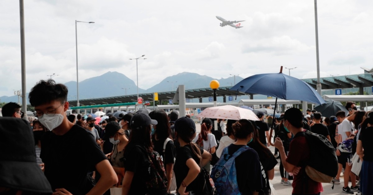 An aircraft takes off as pro-democracy protesters gather outside the airport in, Hong Kong, Sunday, Sept.1, 2019. (AP Photo)