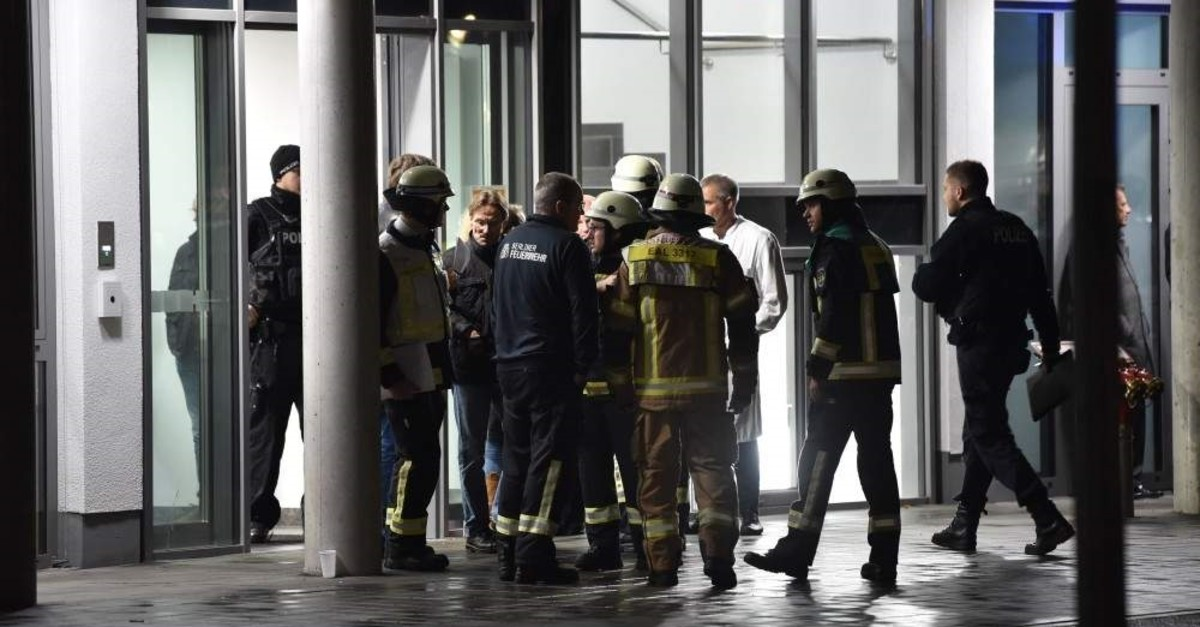 Policemen, firefighters and medical staff stand in front of the hospital after a doctor was stabbed to death as he delivered a lecture at the Schlosspark hospital in the western Berlin neighborhood of Charlottenburg, on November 19, 2019. (AFP Photo)