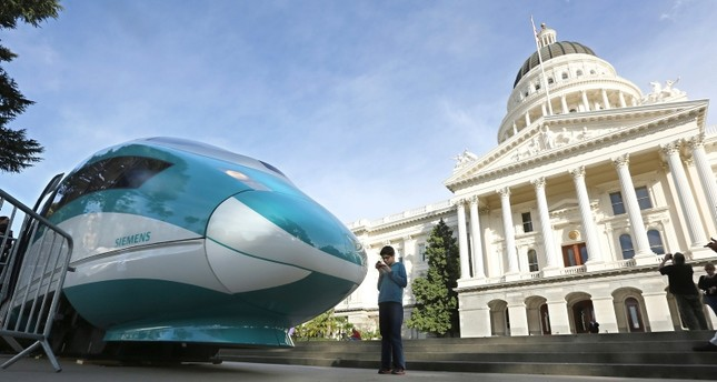 In this Feb. 26, 2015, file photo, a full-scale mock-up of a high-speed train is displayed at the Capitol in Sacramento, Calif. (AP Photo)