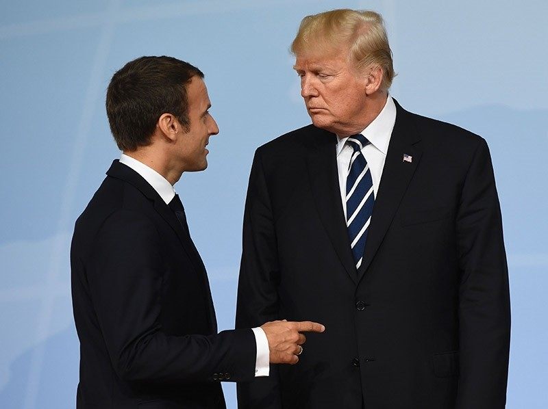 This file photo taken on July 07, 2017 shows US President Donald Trump (R) and French President Emmanuel Macron talking after posing for the family photo on the first day of the G20 summit in Hamburg, northern Germany. (AFP Photo)