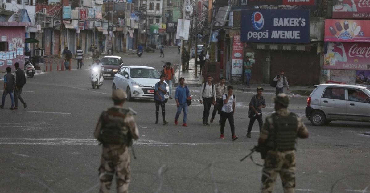 Indian paramilitary soldiers stand guard during curfew like restrictions in Jammu, India, Monday, Aug. 5, 2019. (AP Photo)