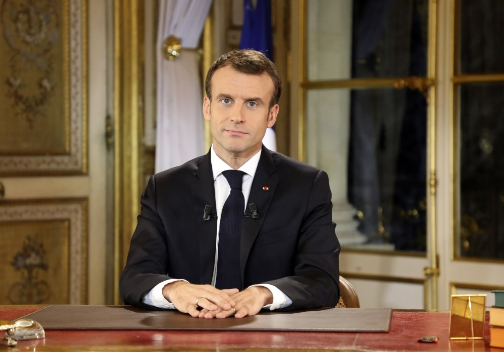 French President Emmanuel Macron poses before a special address to the nation, at the Elysee Palace, Paris, Dec. 10.