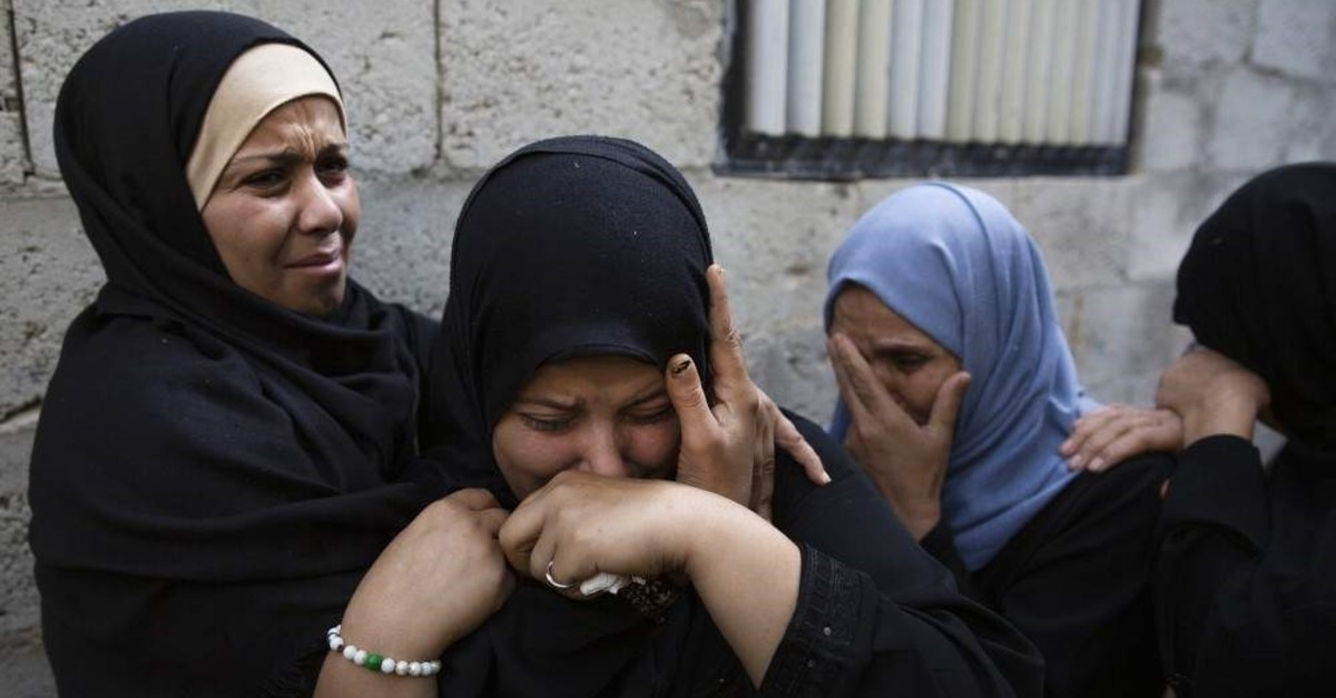 Relatives of Abdullah Al-Belbesi, 26, who was killed in Israeli airstrikes, mourn his death in the family home during his funeral in town of Beit Lahiya, Northern Gaza Strip, Wednesday, Nov. 13, 2019. (AP Photo)