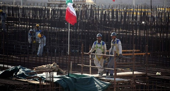 A picture taken on November 10, 2019, shows workers on a construction site in Iran's Bushehr nuclear power plant. (AFP Photo)