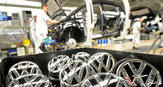 Volkswagen emblems are pictured in a production line at the plant of the German carmaker in Wolfsburg.