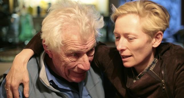 Legendary actress Tilda Swinton (R) and John Berger.