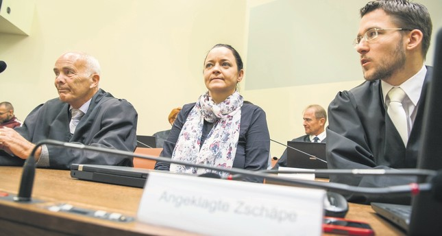 Terror suspect Beate Zschaepe (C) sits between her lawyers Hermann Borchert (L) and Mathias Grasel (R) in the court room in Munich, Germany, July 3.