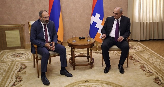 Armenia's Prime Minister Nikol Pashinian, left, and the President Bako Sahakyan of the separatist Nagorno-Karabakh region speak during their meeting in the capital Stepanakert, Wednesday, May 9, 2018. AP Photo