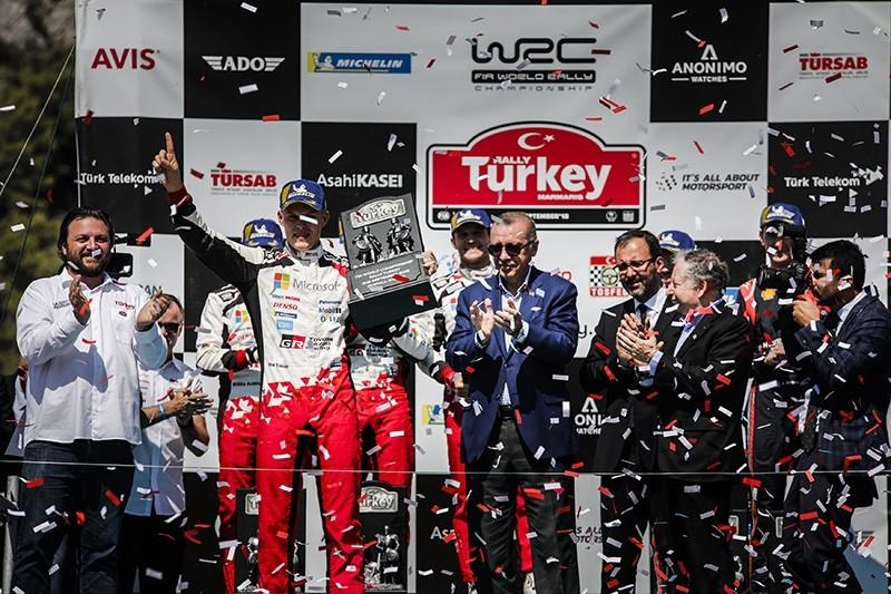 Overall winner Ott Tanak of Estonia (CR) hoists his trophy beside President Recep Tayyip Erdou011fan at the Rally Turkey 2018, Marmaris, Turkey, Sept. 16, 2018. (DHA Photo)