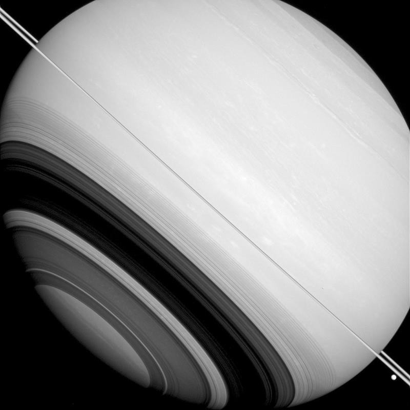 This Aug. 14, 2014 image made available by NASA shows shadows of Saturn's rings projected on the southern hemisphere of the gas giant